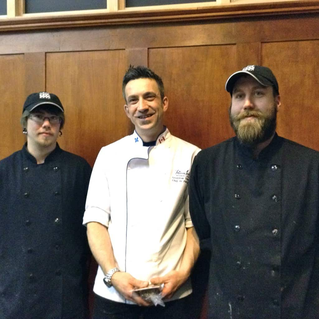Geoffroy Dextraze (picuted in white), flagged by Chef Chris Kopp on the right and sous chef Bryce White on the left.