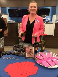 A lovely BMO employee helps serve the wine during the recent Chocolate & Wine Pairing event in Winnipeg.